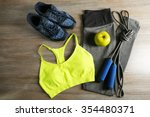 sport clothes  shoes on wooden... | Shutterstock . vector #354480371