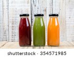 glasses of tasty fresh juice ... | Shutterstock . vector #354571985