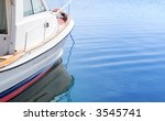 White Boat On Tranquil Blue...