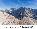 male hiker walking to the top... | Shutterstock . vector #354640685