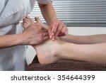 close up of a man's feet... | Shutterstock . vector #354644399