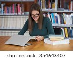 student in the library          ... | Shutterstock . vector #354648407