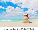 smiling sandy snowman in red... | Shutterstock . vector #354657149