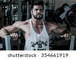 man working out at the gym | Shutterstock . vector #354661919