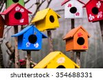 Colorful Birdhouses In The...