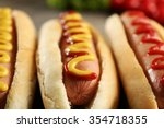 Stock photo tasty hot dogs with vegetables on wooden background close up 354718355