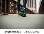 woman athlete feet and shoes... | Shutterstock . vector #354739241