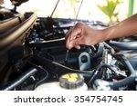 car's mechanic checking oil.   Shutterstock . vector #354754745