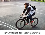 hipster young man riding fixed... | Shutterstock . vector #354860441
