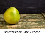 Small photo of Fruit of a pummel on an old wooden table