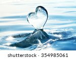icicle in the form of heart on... | Shutterstock . vector #354985061