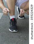 running man tying shoelaces in... | Shutterstock . vector #355224329