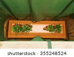 a wooden coffin covered with...   Shutterstock . vector #355248524