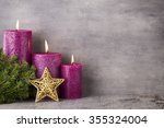 Three Purple Candles On Gray...