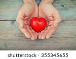men's hands holding decorative... | Shutterstock . vector #355345655