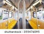 inside train has row of yellow... | Shutterstock . vector #355476095