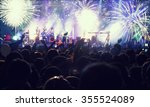 fireworks and crowd celebrating ... | Shutterstock . vector #355524089