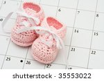 Pink Baby Booties On A Calenda...