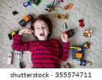 little child playing with lots... | Shutterstock . vector #355574711