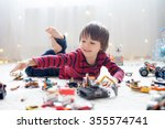 little child playing with lots... | Shutterstock . vector #355574741