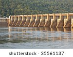 Guntersville Dam on the Tennessee River showing boats and fishermen in the water.