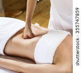 Small photo of Beautiful young woman having visceral massage. Close-up