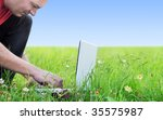 a man on the meadow tipping on... | Shutterstock . vector #35575987