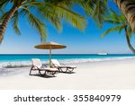 beds and umbrella on a tropical ... | Shutterstock . vector #355840979