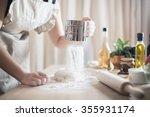 woman preparing dough basis... | Shutterstock . vector #355931174