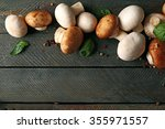 Fresh Mushrooms On Wooden...