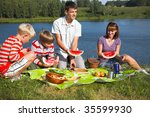 family resting on the lake | Shutterstock . vector #35599930