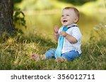 A A Little Boy Playing Outdoors