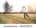 young woman running outdoors in ... | Shutterstock . vector #356078051