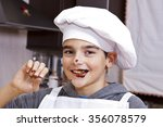 child clothes chef making cakes | Shutterstock . vector #356078579