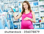 Pregnant Shopping. Young Woman...