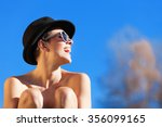 portrait of naked girl with hat ... | Shutterstock . vector #356099165