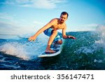 surfer boy on his surf board in ... | Shutterstock . vector #356147471