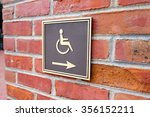 Small photo of Arrow points to the right for wheelchair access in San Francisco.