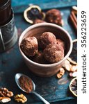 Small photo of Raw chocolate candy with nuts, figs and citrus, truffle, healthy vegan dessert,selective focus