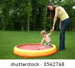 Mom And Son Playing Outdoors I...
