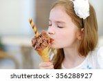 Adorable Little Girl Eating...