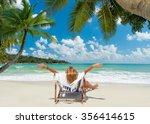 girl on a tropical beach in... | Shutterstock . vector #356414615
