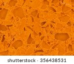 Small photo of beautiful orange stone agglomerate with solid patches of different shapes of the various form
