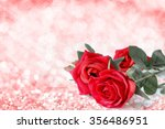 Stock photo red roses bouquet with bokeh and free space for text valentine twinkled bright background 356486951
