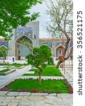 Small photo of SAMARKAND, UZBEKISTAN - APRIL 30, 2015: The small weeping tree in the middle of the flower bed in the courtyard of Tilya Kori Madrasah, on April 30 in Samarkand.