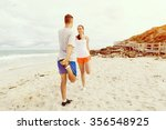 runners. young couple doing... | Shutterstock . vector #356548925