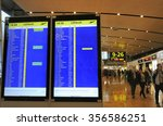 HELSINKI, FINLAND - NOVEMBER 16:Travelers and shops at Helsinki International Airport. In front a departure board. November 16, 2015 Helsinki, Finland - stock photo