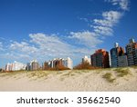 Buildings and sand dune. Montevideo, Uruguay - stock photo