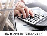 businessman using a calculator... | Shutterstock . vector #356649647
