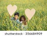 asian couple holding heart... | Shutterstock . vector #356684909